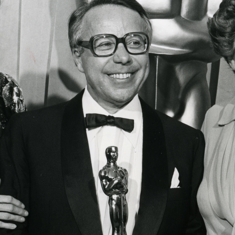 "Kudelski with actors Maggie Smith (left) and Maureen Stapleton at the 1978 Academy Awards. That year, Kudelski won a Scientific and Engineering award for improvements ""in the Nagra 4.2L sound recorder for motion picture production."" It was one of four Oscars awarded Kudelski in his lifetime."
