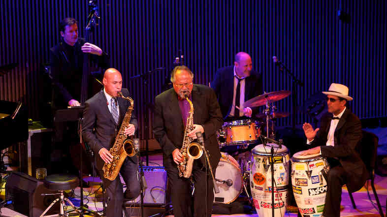 Saxophonists Joshua Redman (center) and Joe Lovano (left) lead a performa