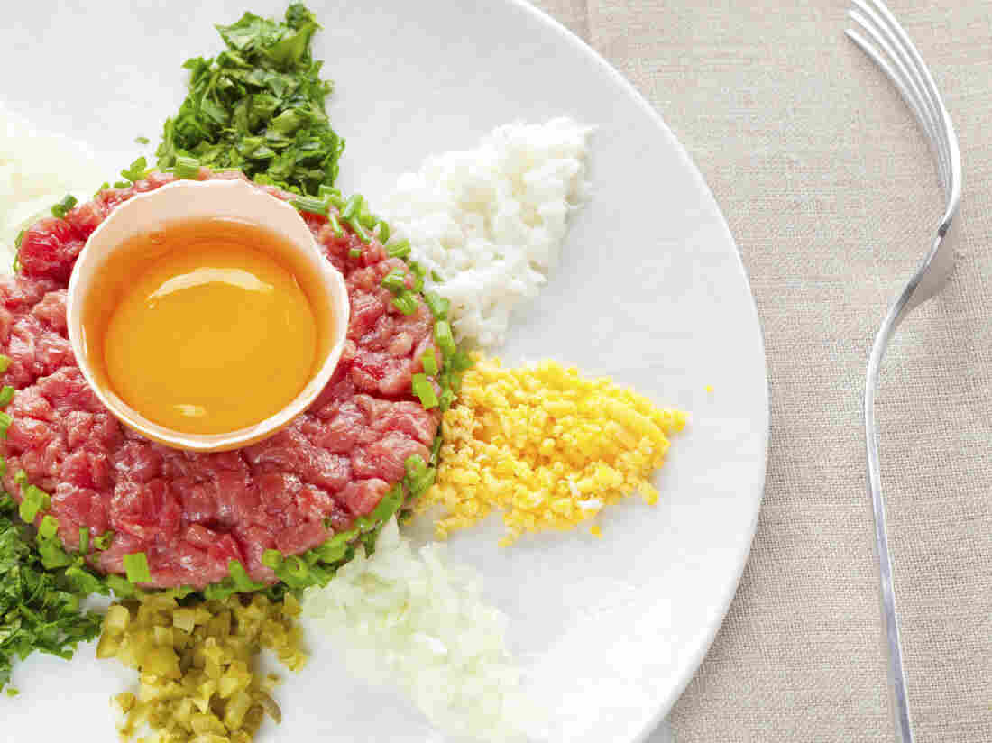 A traditional steak tartare with egg, onion and capers.