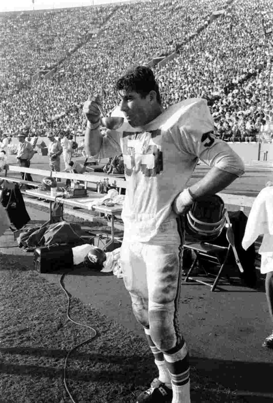 Chiefs linebacker E.J. Holub, drinking from what looks to be a ladle.