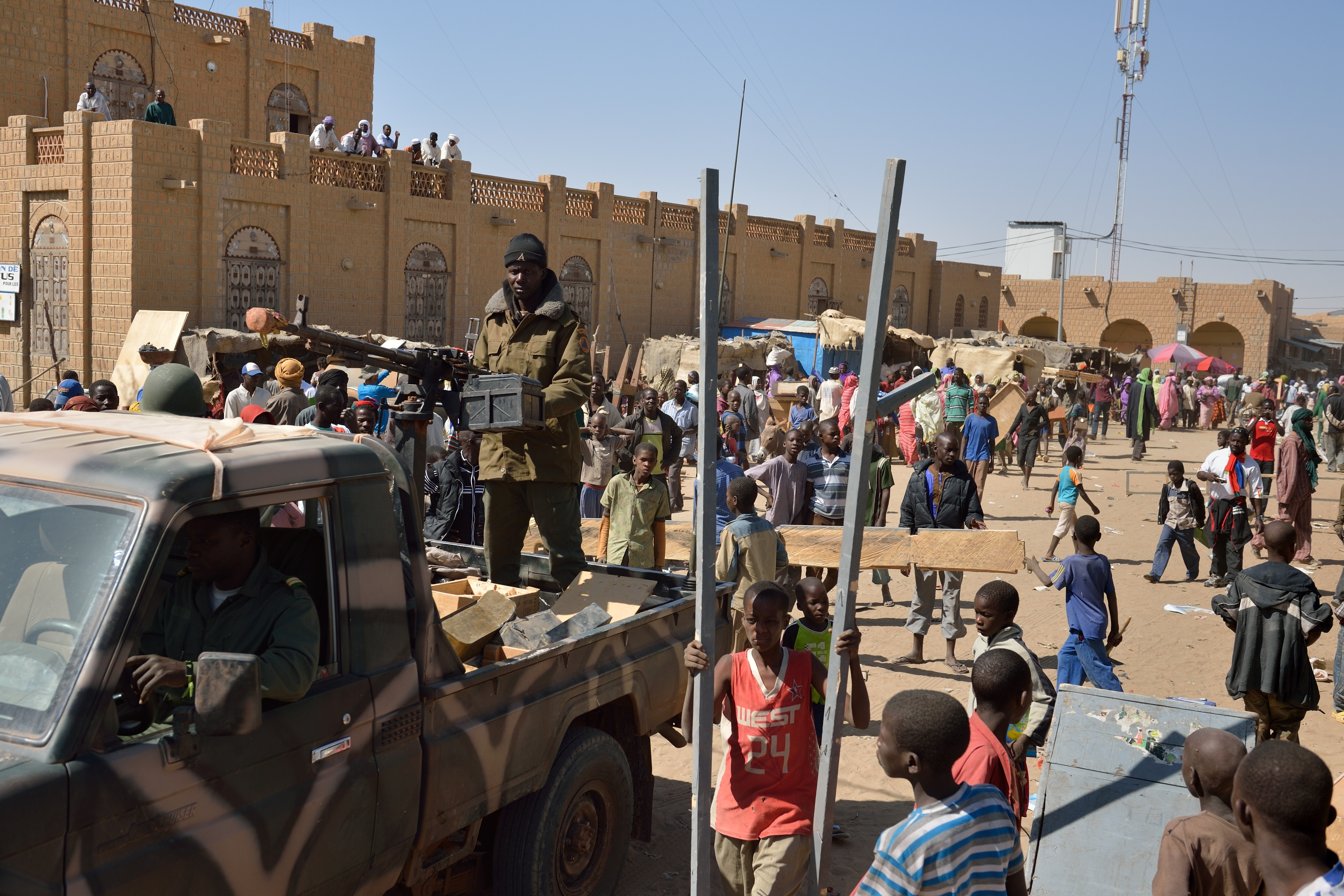 Malian soldiers patrol Timbuktu on Tuesday to keep looters at bay.