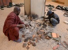 Men recover burnt ancient manuscripts at the Ahmed Baba Institute in Timbuktu on Tuesday.