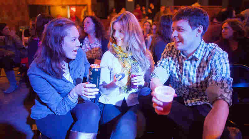 Ask Me Another audience members enjoy some potent potables from The Bell House's esteemed bartenders.