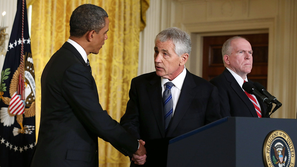 President Obama shakes hands with his nominee to head the Defense Department, former Sen. Chuck Hagel, at the White House on Jan. 7. John Brennan, Obama's choice for director of the CIA, looks on. (Getty Images)