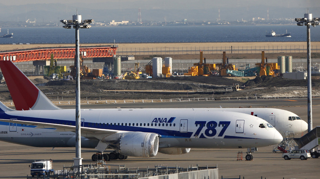 Investigators are still looking into the cause of fires and overheating aboard Boeing's new 787s. (AP)