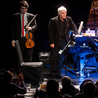 Conductor and pianist Daniel Barenboim (center) brought members of his West-Eastern Divan Orchestra (including his son Michael Barenboim, left, and Kinan Azmeh) to the intimate spaces of Manhattan's Le Poisson Rougue.