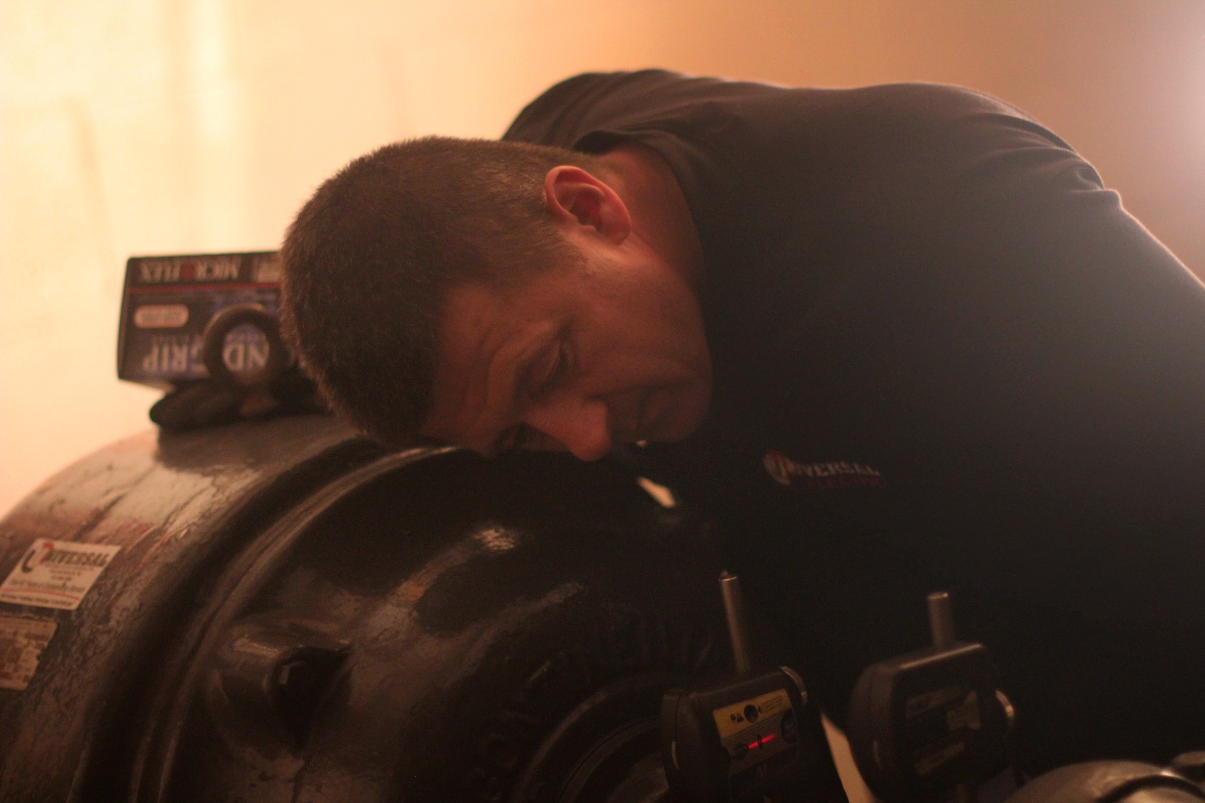Mechanic Robert Sudo adjusts the motor of a powerful water pump that was knocked out by flooding.