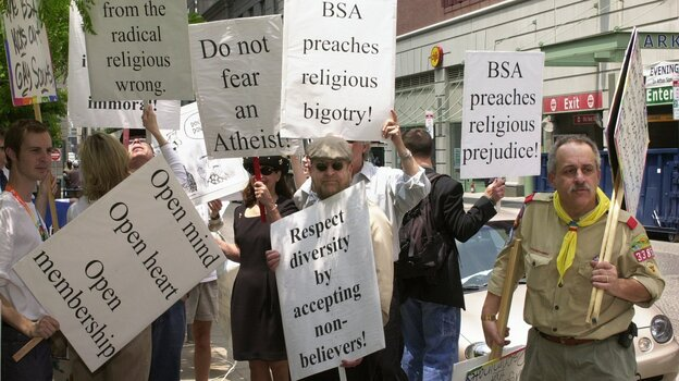 The Supreme Court upheld the Boy Scouts' right to discriminate in 2000, but the issue roiled for years after. Scott Cozza (right) leads a protest outside the National Council Conference of the Boy Scouts of America in Philadelphia in 2003. (AP)