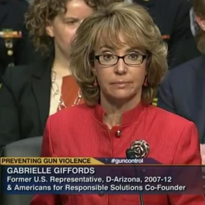 Former Rep. Gabrielle Giffords, D-Ariz., at a Senate Judiciary Committee hearing Wednesday. Her husband, retired astronaut Mark Kelly, to the right.