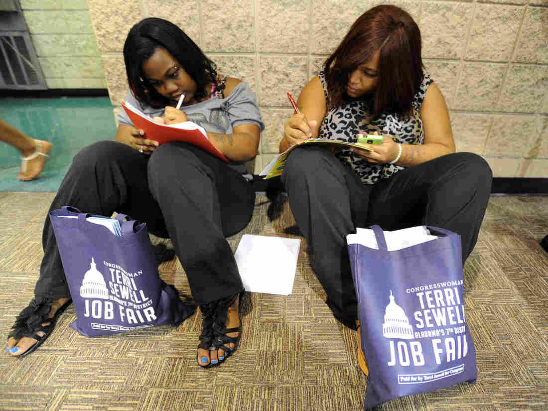 Looking for work: In Birmingham, Ala., last summer, Jessica McQueen (left) and Ashley Abramson were among those filling out applications at a jobs fair.