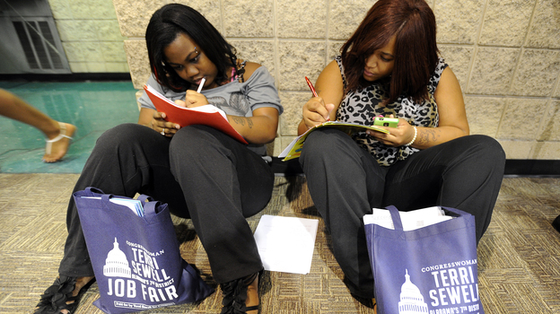 Looking for work: In Birmingham, Ala., last summer, Jessica McQueen (left) and Ashley Abramson were among those filling out applications at a jobs fair. (Birmingham News /Landov)