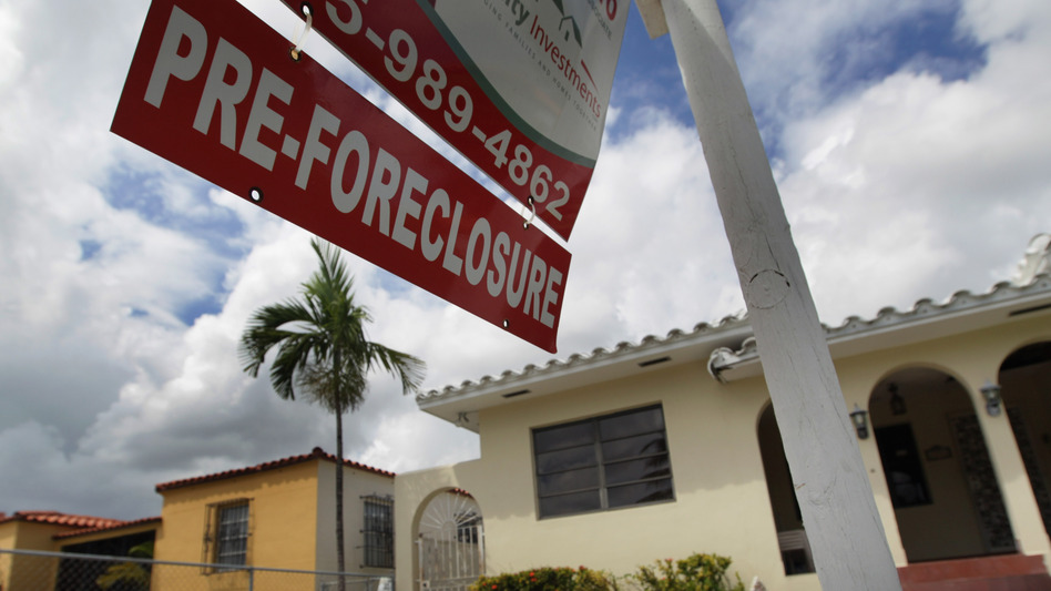 A sign hangs outside a house in Miami in 2010. Currently, Florida's foreclosure legal process can take a couple of years, which critics say is hurting the housing market. (Getty Images)