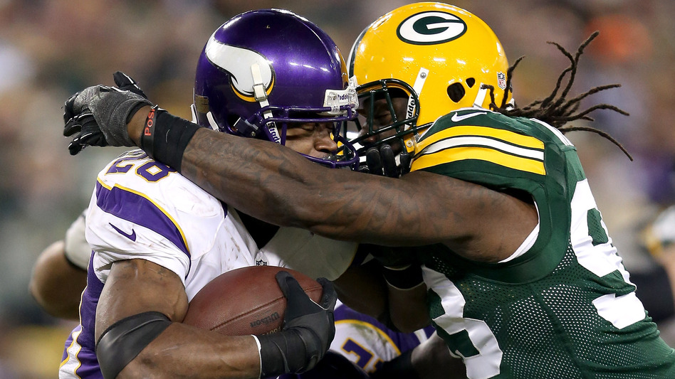 Green Bay Packers Erik Walden hits Minnesota Vikings Adrian Peterson during the NFC Wild Card Playoff game this year. (Getty Images)