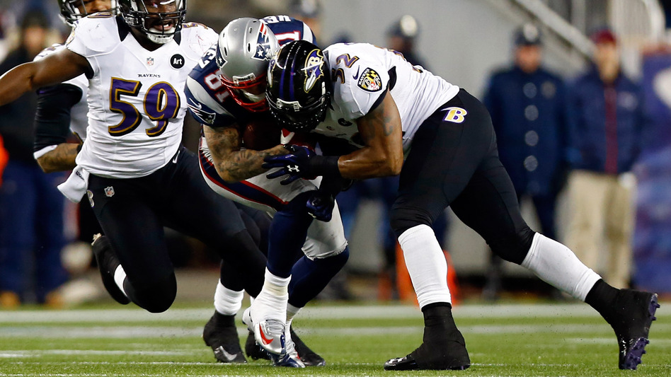 Baltimore Ravens Ray Lewis tackles New England Patriots Aaron Hernandez with his helmet during the 2013 AFC Championship game this year. (Getty Images)