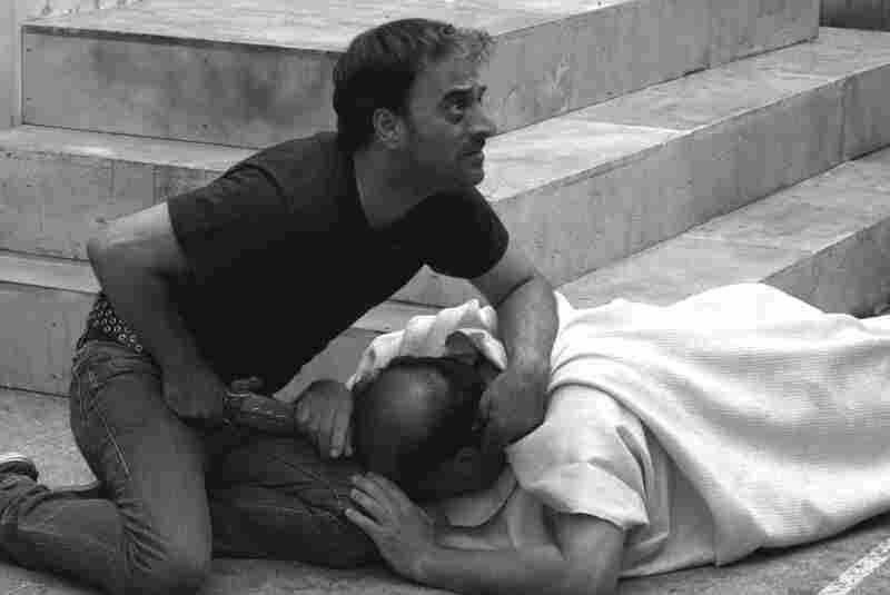 Brutus (Salvatore Striano) delivers the final blow to the dying Caesar (Giovanni Arcuri) during a performance of Shakespeare's Julius Caesar in the film Caesar Must Die.