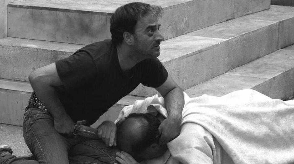 Brutus (Salvatore Striano) delivers the final blow to the dying Caesar (Giovanni Arcuri) during a performance of Shakespeare's <em>Julius</em> <em>Caesar </em>in the film <em>Caesar Must Die.</em>