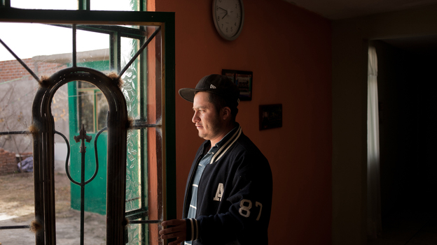 Armando Tenorio at his home in Mexico last December. Tenorio spends most of the year working on a blueberry farm in Canada, on a temporary work permit, to support his family in Mexico. (The Washington Post/Getty Images)