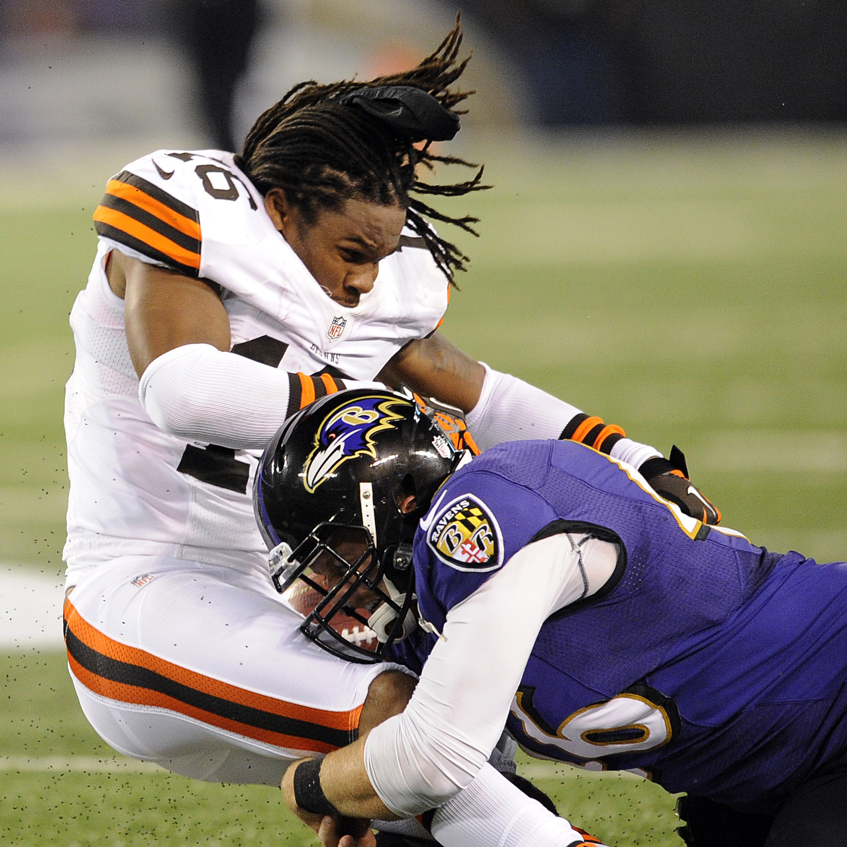 Baltimore Ravens Morgan Cox tackles Cleveland Browns wide receiver Josh Cribbs as Cribbs' helmet is dislodged from a hit by another player in a game last September.