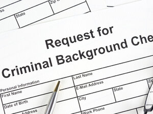 "Form that states ""Request for Criminal Background Check"" with a pen"