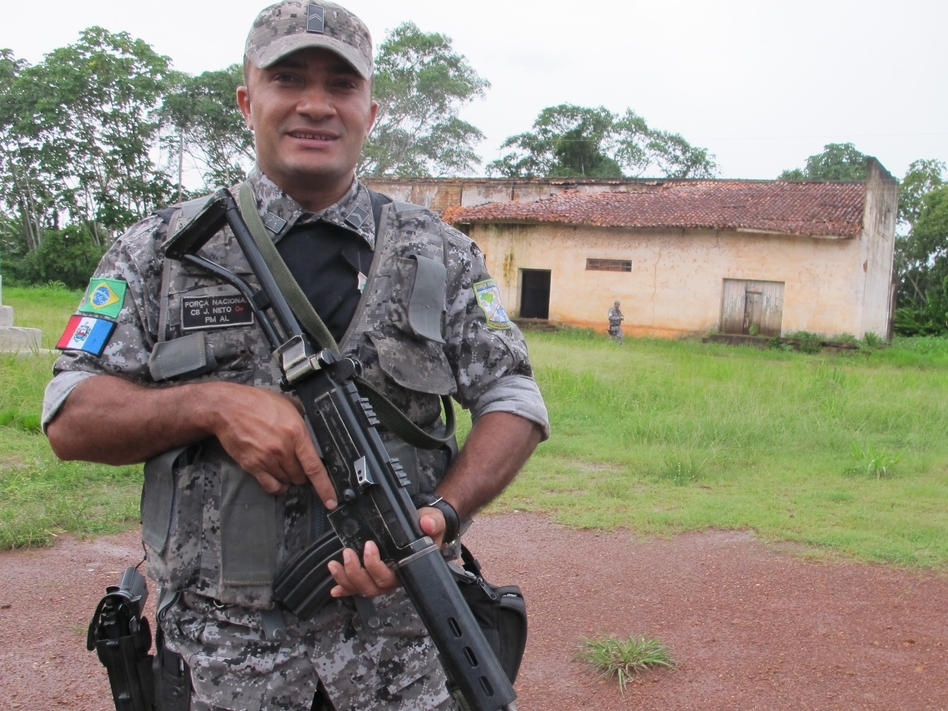 An agent of Brazil's Forca Nacional, an agency made up of military policemen, stands guard in a largely abandoned border hamlet that is used by drug traffickers to ferry cocaine from neighboring Bolivia. (Juan Forero/NPR)