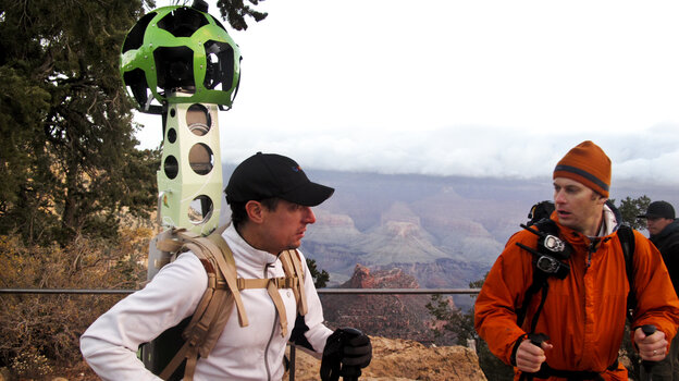 Google's Craig Robinson and James Hoffacker prepare to hike into the Grand Canyon. Robinson is wearing the new Google Trekker — a Street View camera mounted to a backpack. The Trekker's two lithium ion batteries can last eight hours and power 15 cameras. The pack — designed and built by Google — weighs 40 pounds.