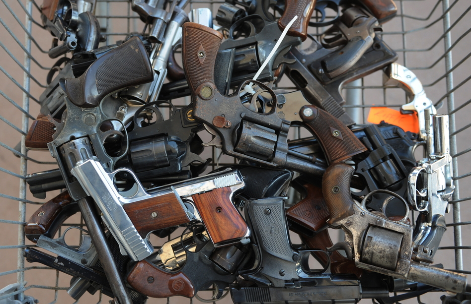 "Handguns collected in South-Central Los Angeles as part of a Gun for Gift Card exchange in 2009. One teenager here says getting a gun on the streets is just ""one phone call away."""