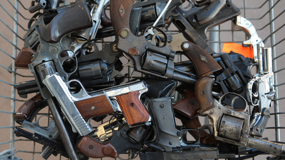 "Handguns collected in South-Central Los Angeles as part of a Gun for Gift Card exchange in 2009. One teenager here says getting a gun on the streets is just ""one phone call away."" (AFP/Getty Images)"