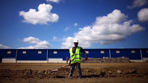 Workers prepare the foundation for a new warehouse and manufacturing facility at the Caracol Industrial Park in northern Haiti. The park, which opened last year, is still under construction. (NPR)