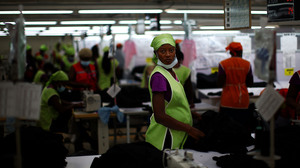 Backers of the industrial park project say it could create 60,000 jobs inside the park. Here, workers at the SAE-A textile plant.