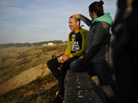 McNamara sits next to his wife, Nicole, after a surf session in Nazare a day after riding the massive wave.