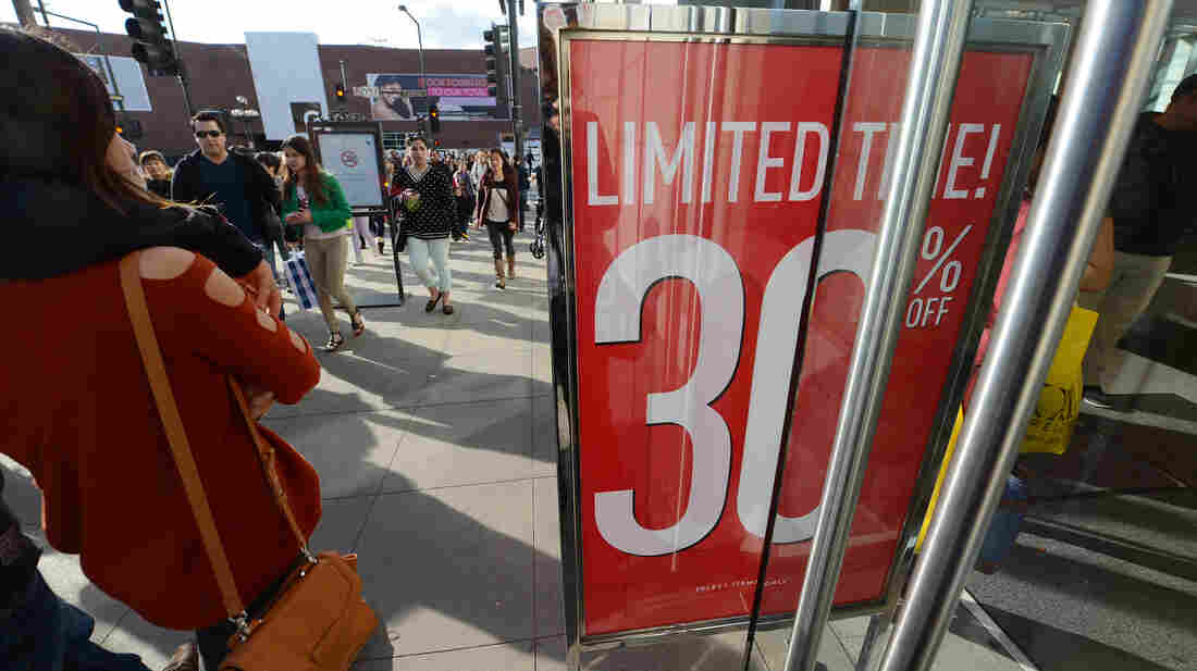 Consumer spending rose in 2012, but not by as much as the year before. In December, these shoppers were out and about in Glendale, Calif.