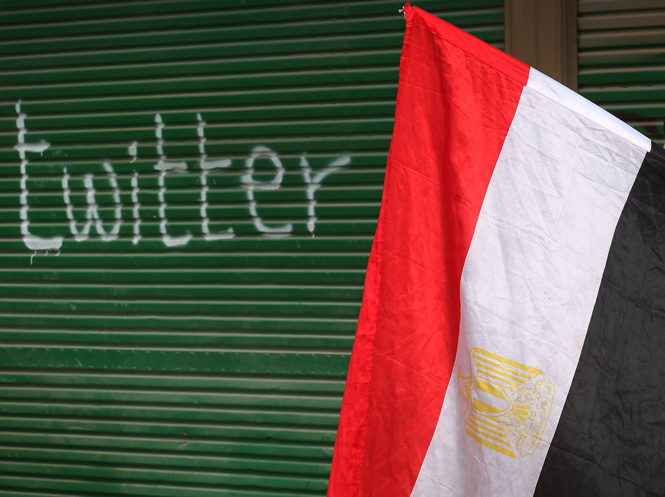 "A shop in Tahrir Square is spray-painted with the word ""twitter"" after the government shut off Internet access in February 2011 in Cairo, Egypt. (Getty Images)"