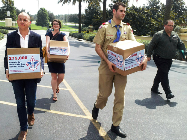 Eagle Scout Zach Wahls delivers cartons of petitions to the Boys Scouts of America national board meeting in Orlando, Fla., last May, calling for an end to anti-gay discriminatory practices. Helping to carry the cartons are Mark Anthony Dingbaum and Christine Irvine of Change.org.