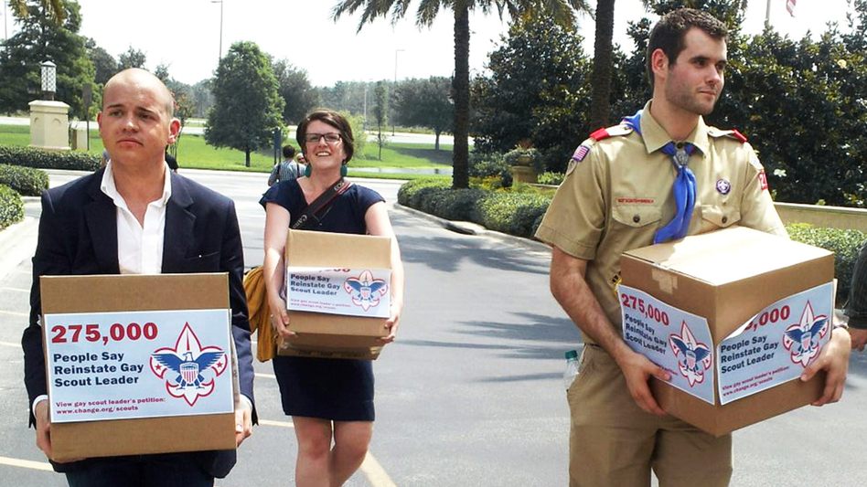 Eagle Scout Zach Wahls delivers cartons of petitions to the Boys Scouts of America national board meeting in Orlando, Fla., last May, calling for an end to anti-gay discriminatory practices. Helping to carry the cartons are Mark Anthony Dingbaum and Christine Irvine of Change.org. (Reuters/Landov)