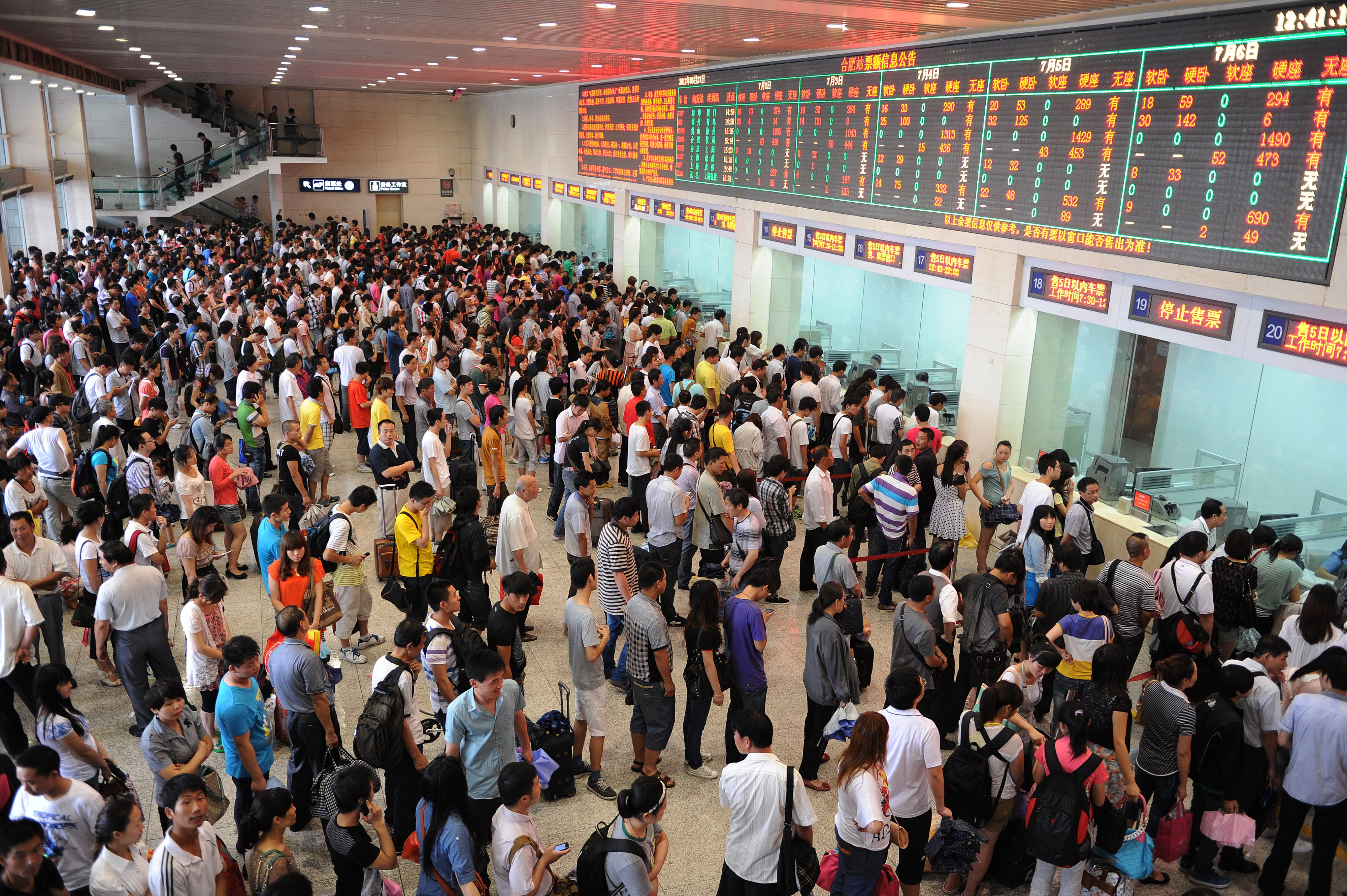 Chinese passengers line up to buy train tickets as the summer holiday starts in Hefei, in eastern China's Anhui province, in June 2012. China's railways transported some 453 million passengers during the first quarter of 2012.