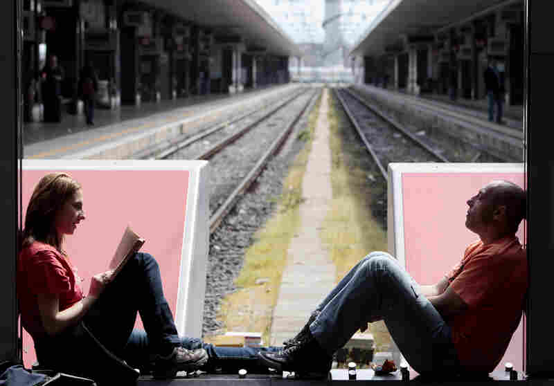 Passengers wait for their train in Rome's Termini Station, in April 2011, during a transport strike that idled trains, buses and subways across Italy.