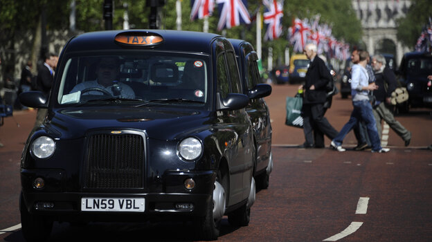 Black taxis drive down The Mall in London. A Chinese company rescued the British automaker that manufactures the famous cabs.