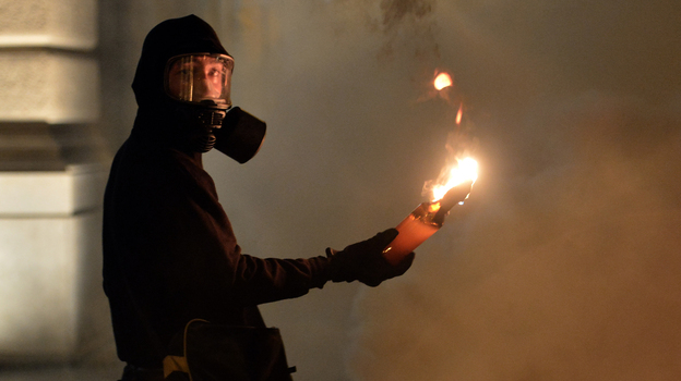 A protester holds a petrol bomb during clashes with riot police after a demonstration against new austerity measures outside the parliament in Athens, Greece, on Nov. 7. (AFP/Getty Images)