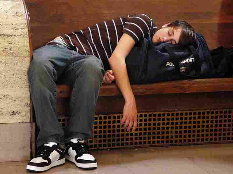Andrew Michael, who had been waiting for hours, takes a nap as he waits for a train at 30th Street Station in Philadelphia in May 2006. Thousands of Amtrak passengers were stranded from Washington, D.C., to New York during a power outage along the Eastern corridor.