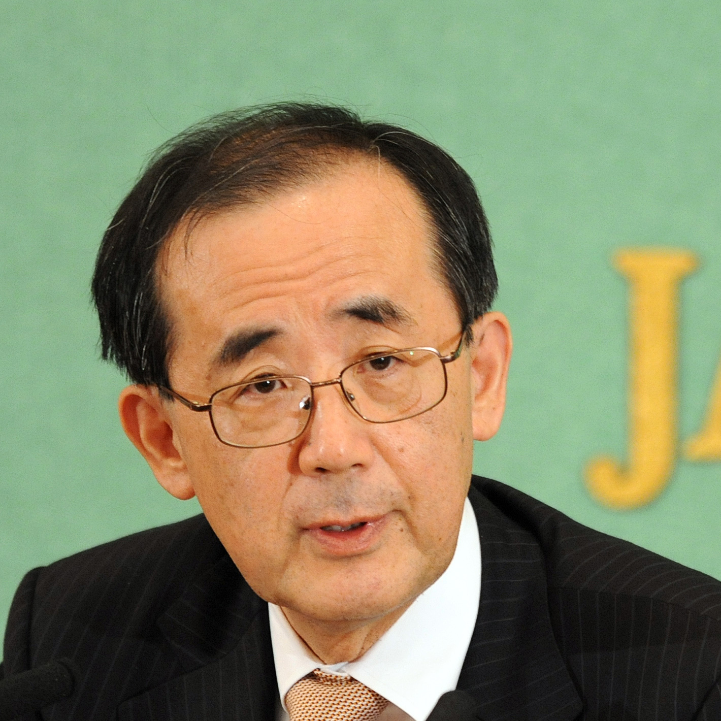 Bank of Japan (BOJ) Governor Masaaki Shirakawa speaks before the press in Tokyo on January 25, 2013. Shirakawa said that the two-percent target is hard to achieve because it needs various efforts including those by the government in reforms in regulations that could be politically difficult. AFP PHOTO / RIE ISHIIRIE ISHII/AFP/Getty Images