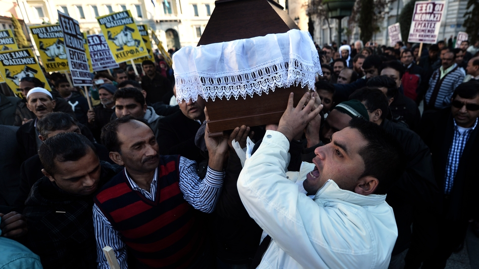Members of the Pakistani community in Athens carry the coffin of Shehzad Luqman, the victim of what appears to have been a racist attack, on Jan. 19. It's the latest in a wave of violence associated with the right-wing, anti-immigrant Golden Dawn party. (AFP/Getty Images)