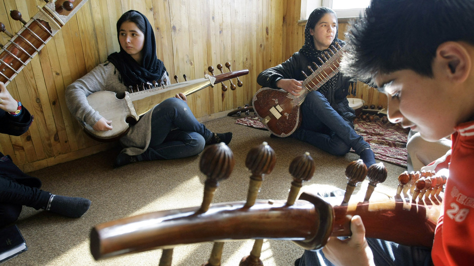 The Afghanistan National Institute of Music in Kabul trains both boys and girls. Here, students practice in January. (AP)