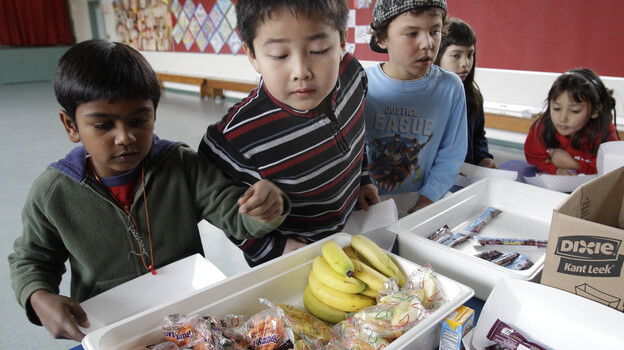 The U.S. Department of Agriculture's proposed new rules for school snacks promote healthier options, like the fruits and vegetables served in this Palo Alto, Calif., cafeteria. (AP)