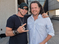 McCormick (right) with singer-songwriter Brantley Gilbert. Gilbert's song