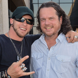"McCormick (right) with singer-songwriter Brantley Gilbert. Gilbert's song ""You Don't Know Her Like I Do,"" which McCormick co-wrote, hit the top of Billboard's Hot Country Songs chart in the summer of 2012."