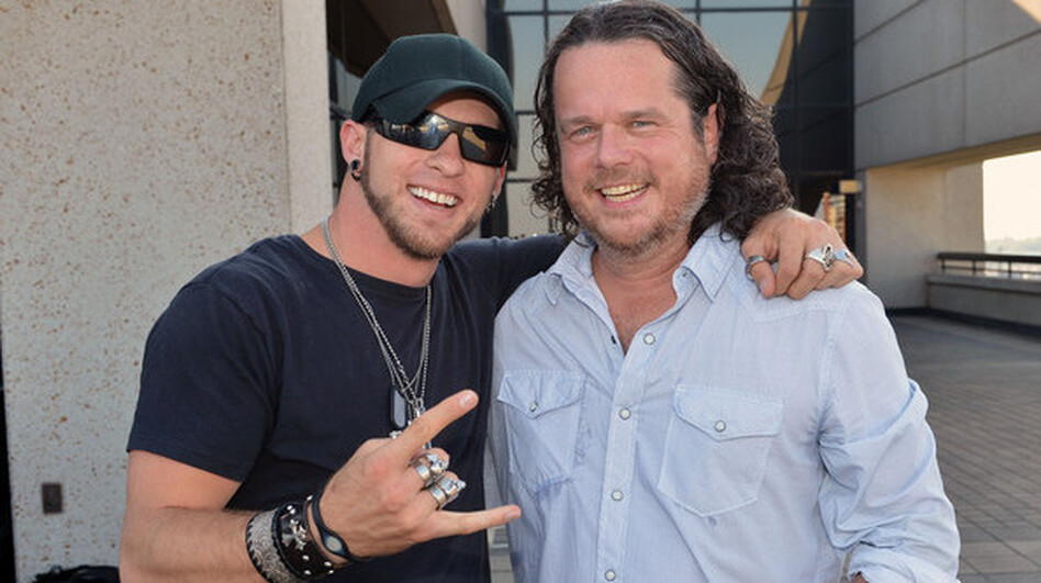 "McCormick (right) with singer-songwriter Brantley Gilbert. Gilbert's song ""You Don't Know Her Like I Do,"" which McCormick co-wrote, hit the top of Billboard's Hot Country Songs chart in the summer of 2012. (Courtesy of the artists)"