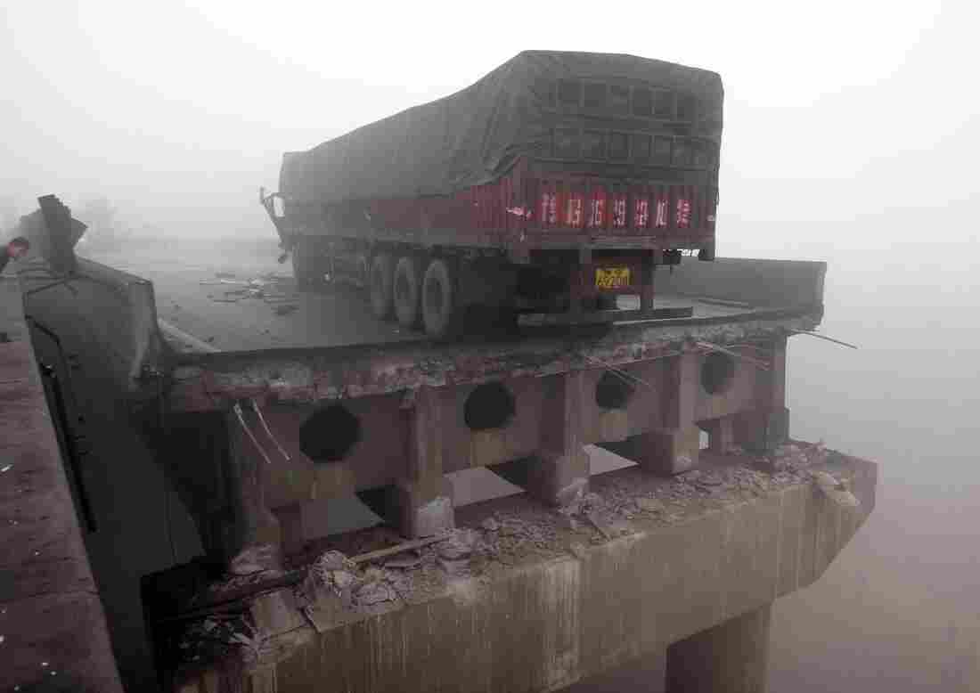 A truck sits on the partially collapsed highway after a truck carrying fireworks exploded on it in Sanmenxia, China on Feb. 1, 2013.