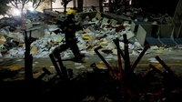 Rescue workers are searching the debris in Mexico City, where an explosion Thursday rocked the headquarters of the state-owned oil company, Pemex.