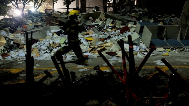 Rescue workers are searching the debris in Mexico City, where an explosion Thursday rocked the headquarters of the state-owned oil company, Pemex. (AFP/Getty Images)