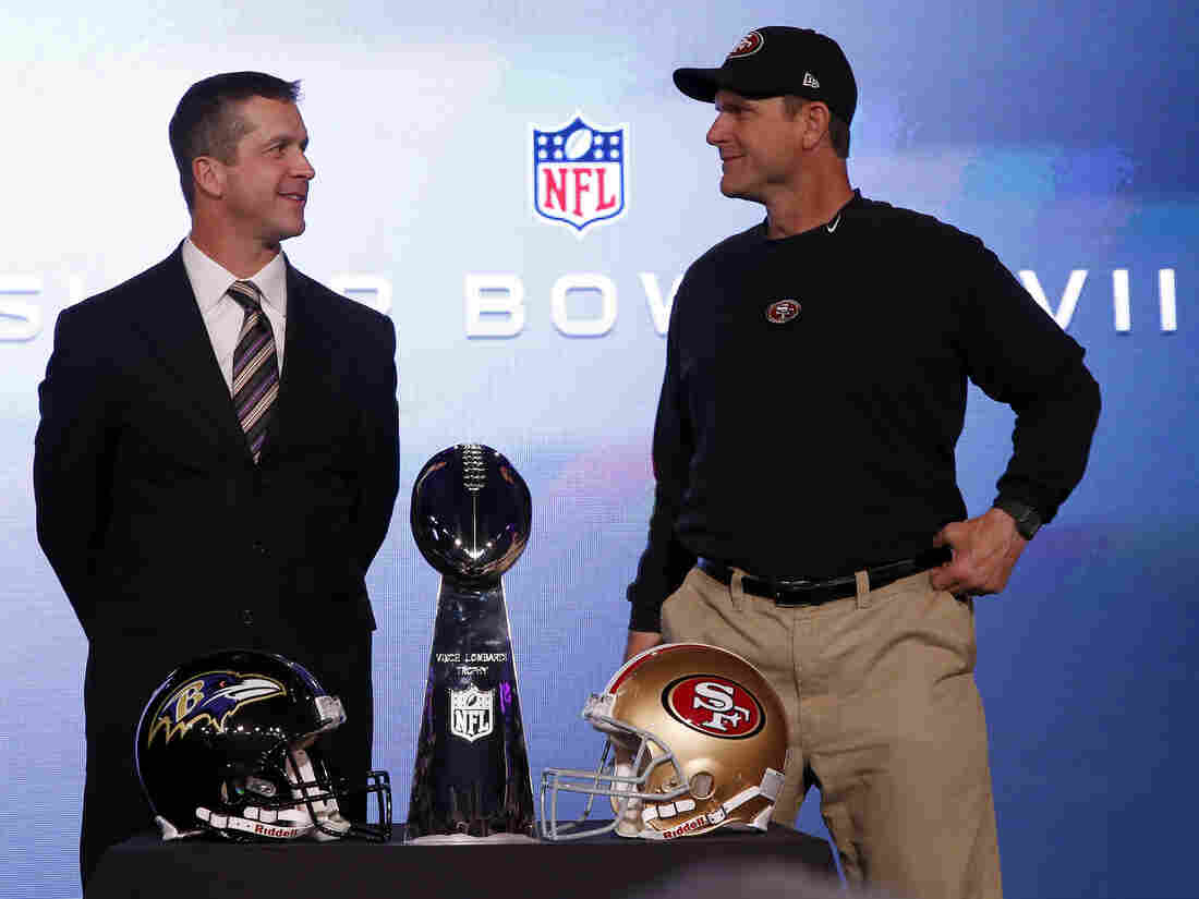 San Francisco 49ers head coach Jim Harbaugh (right) and his brother, Baltimore Ravens head coach John Harbaugh, with the Vince Lombardi trophy ahead of the NFL's Super Bowl XLVII in New Orleans.